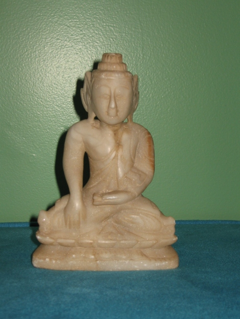A statue I bought while at a massage retreat, up against my green wall.